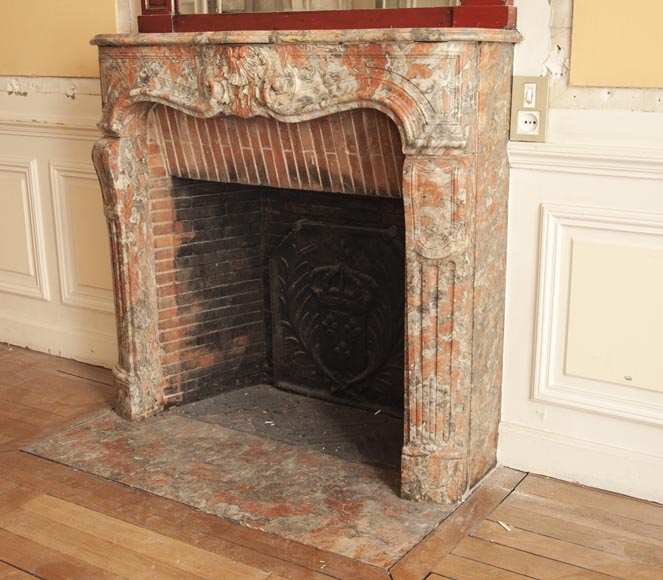 An antique Regence style fireplace made out of Incarnat Turquin marble-5