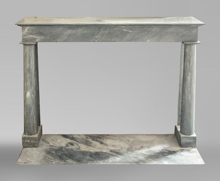 An antique Empire style fireplace made out of blue Turquin marble with detached columns-0