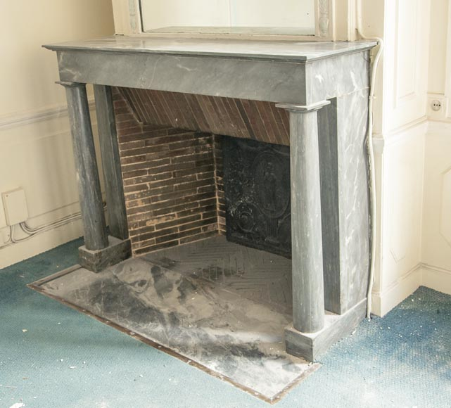 An antique Empire style fireplace made out of blue Turquin marble with detached columns-4