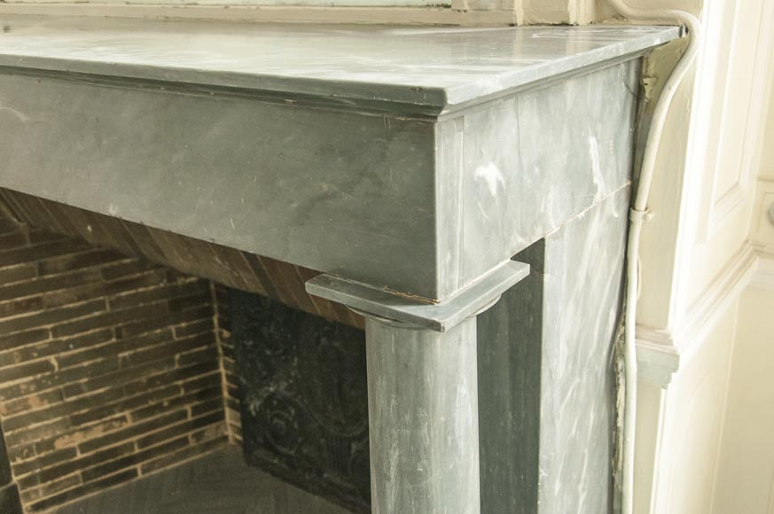 An antique Empire style fireplace made out of blue Turquin marble with detached columns-5