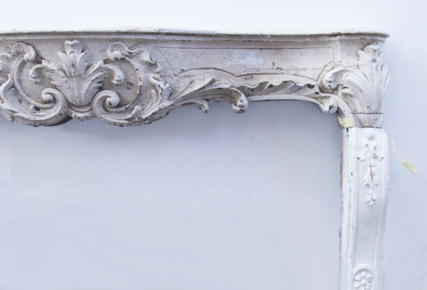 A beautiful antique richly sculpted fireplace from Louis XV period made out of painted oak-8