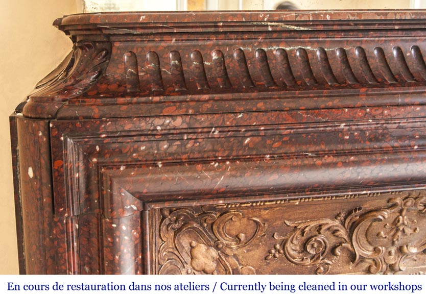 An antique Louis XIV style fireplace, with acroterion and Bollection, made out of Rouge Griotte marble-3