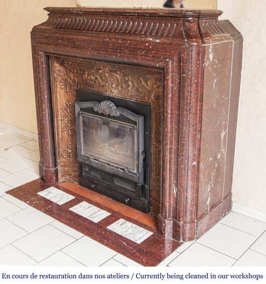 An antique Louis XIV style fireplace, with acroterion and Bollection, made out of Rouge Griotte marble-5