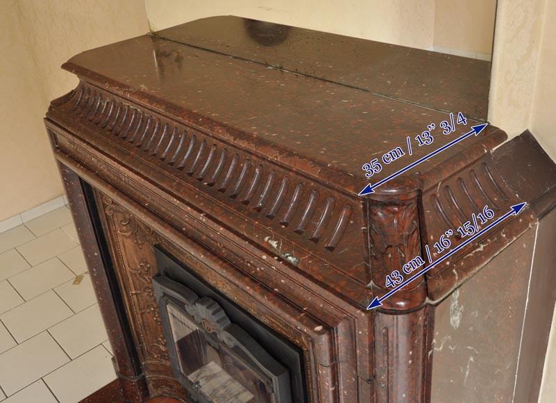 An antique Louis XIV style fireplace, with acroterion and Bollection, made out of Rouge Griotte marble-10