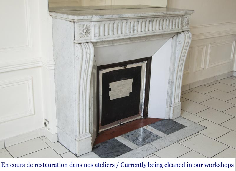 An antique Louis XVI style fireplace with flutes, made out of Carrara marble-2