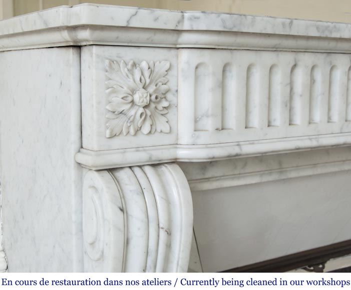 An antique Louis XVI style fireplace with flutes, made out of Carrara marble-3