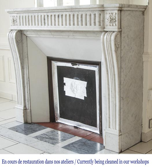 An antique Louis XVI style fireplace with flutes, made out of Carrara marble-5