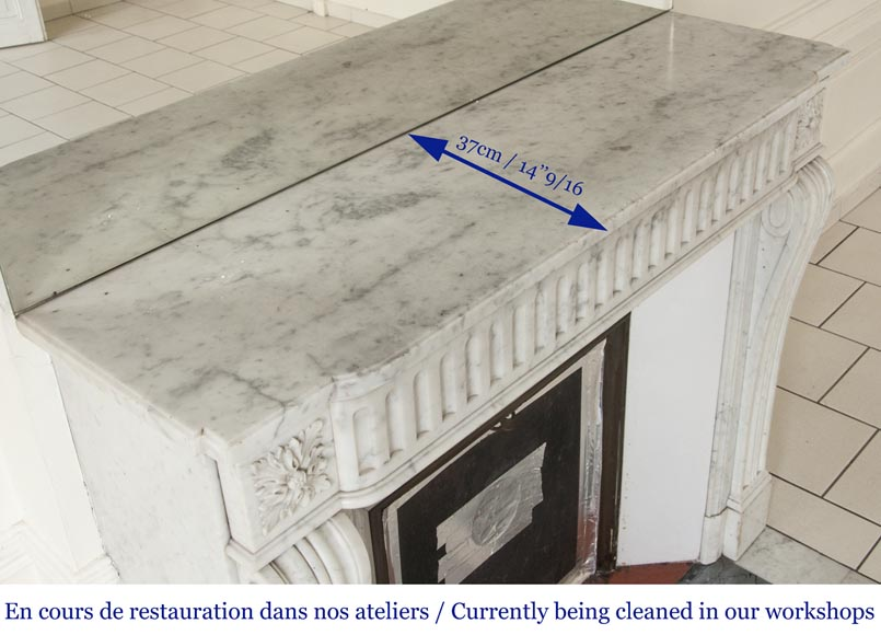 An antique Louis XVI style fireplace with flutes, made out of Carrara marble-8