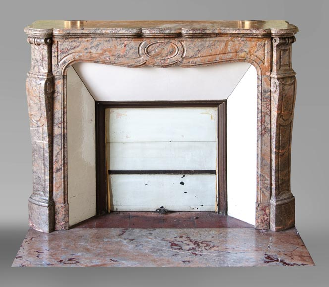 An antique Louis XV style fireplace, Pompadour model, made out of Enjugerais marble-0