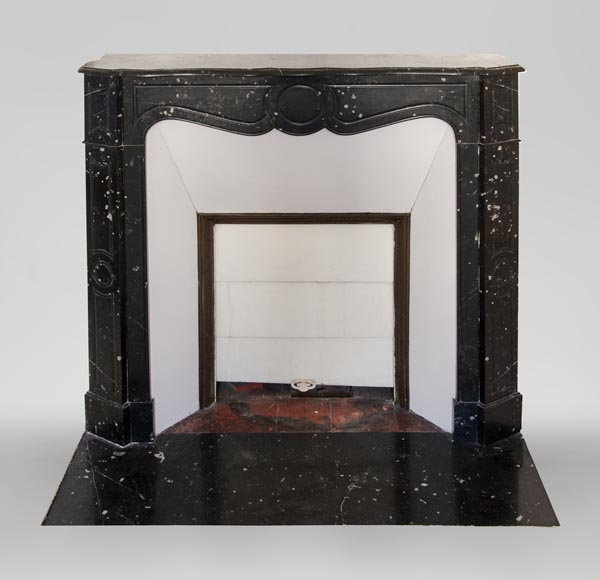 An antique Louis XV style fireplace, Pompadour model, made out of black marble-0