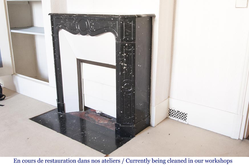 An antique Louis XV style fireplace, Pompadour model, made out of black marble-4