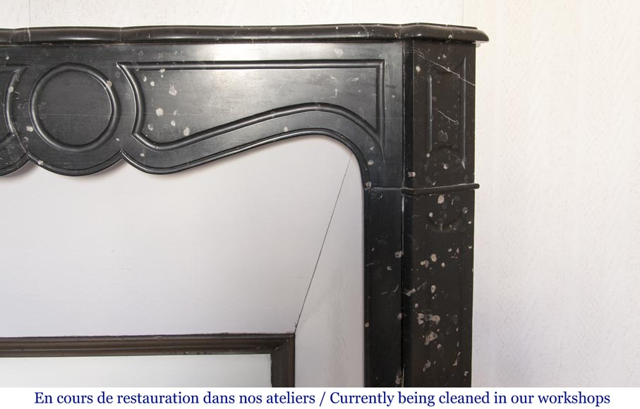An antique Louis XV style fireplace, Pompadour model, made out of black marble-5