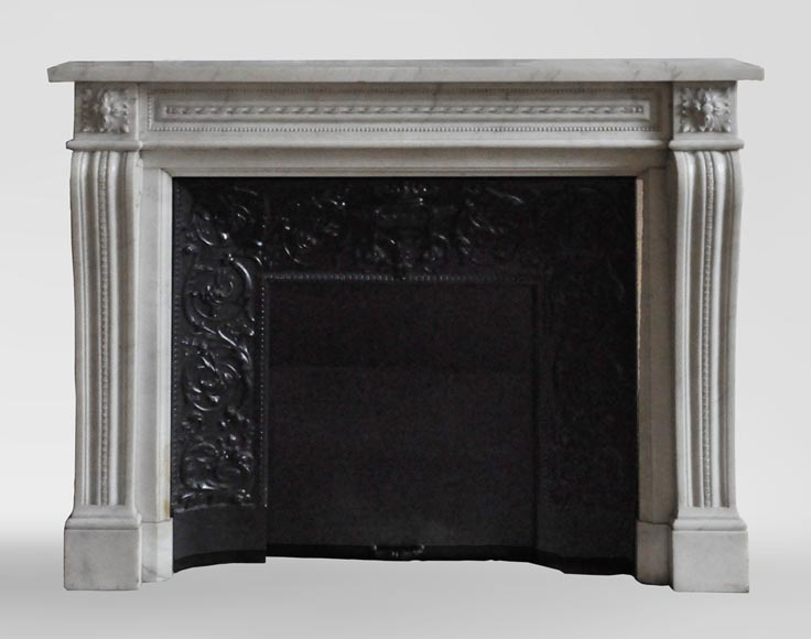 An antique Louis XVI style fireplace made out of Carrara marble-0