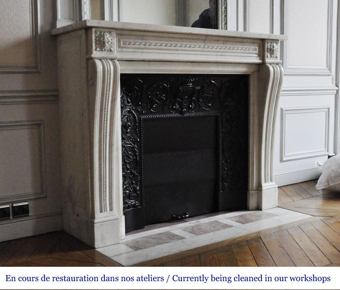 An antique Louis XVI style fireplace made out of Carrara marble-2