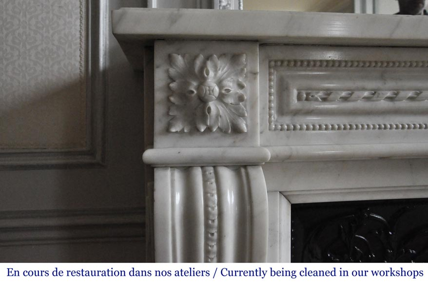 An antique Louis XVI style fireplace made out of Carrara marble-3