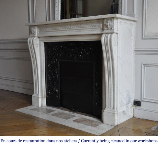 An antique Louis XVI style fireplace made out of Carrara marble-5