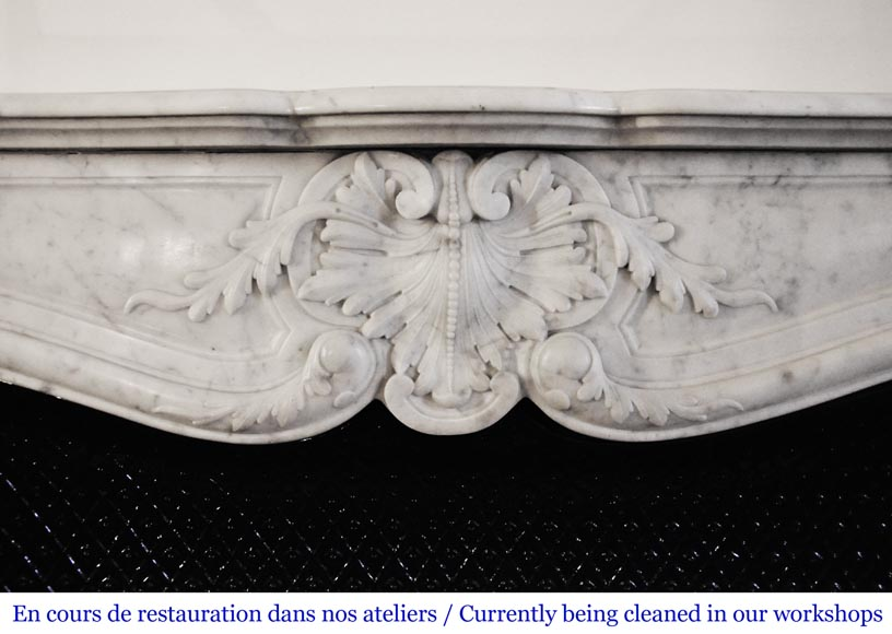 An antique Louis XV style fireplace, made out of Carrara marble, with shell decoration-1