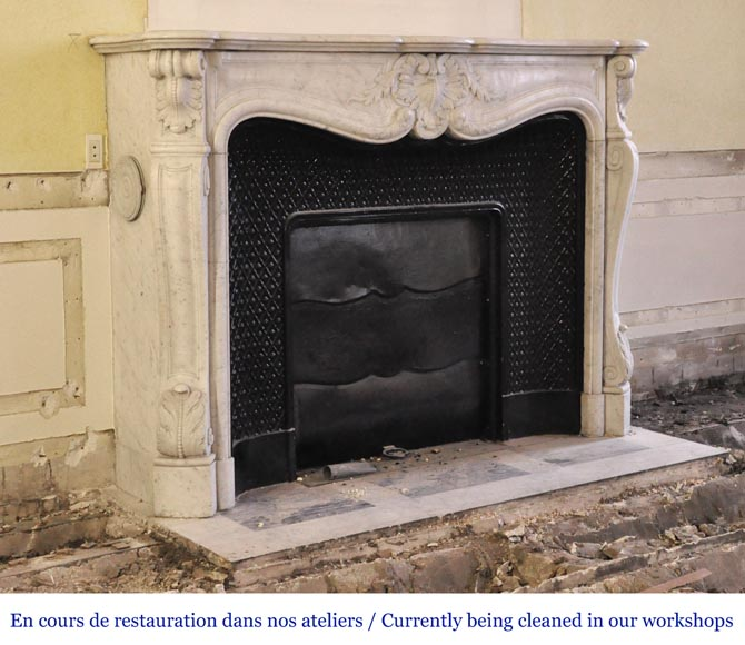 An antique Louis XV style fireplace, made out of Carrara marble, with shell decoration-2