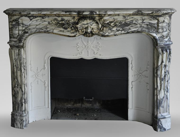 An antique Louis XV style fireplace made out of Brèche Violette marble-0