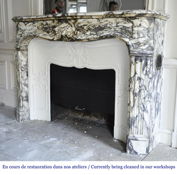 An antique Louis XV style fireplace made out of Brèche Violette marble-7