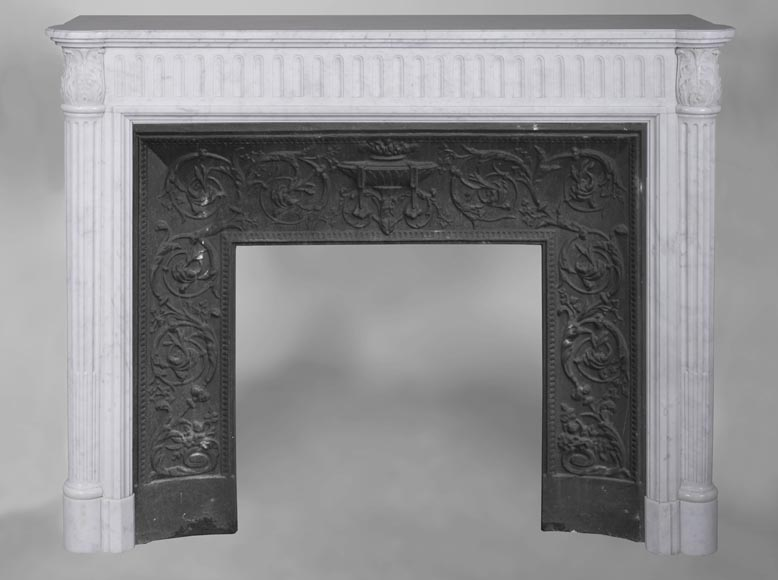An antique Louis XVI style fireplace, made out of Carrara marble, with half-columns-0