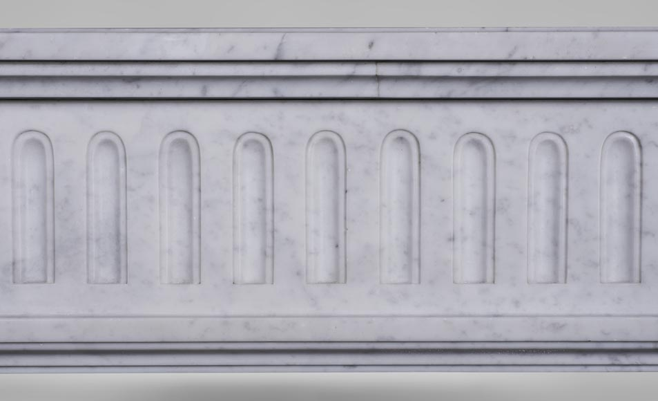 An antique Louis XVI style fireplace, made out of Carrara marble, with half-columns-1