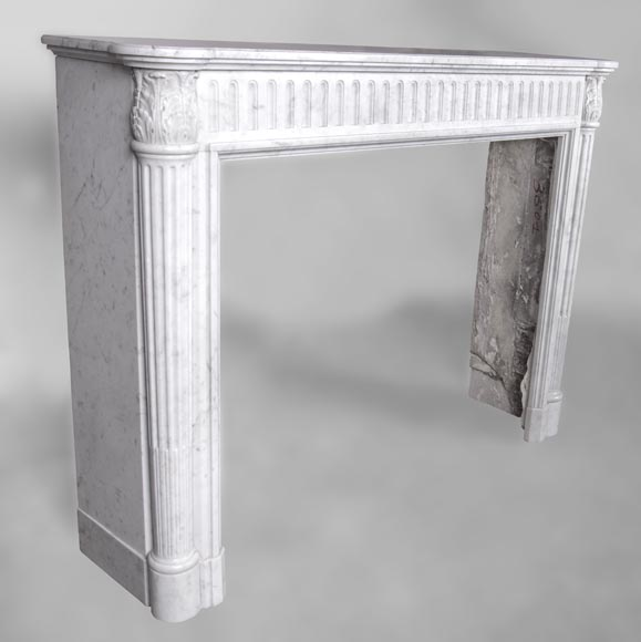 An antique Louis XVI style fireplace, made out of Carrara marble, with half-columns-2