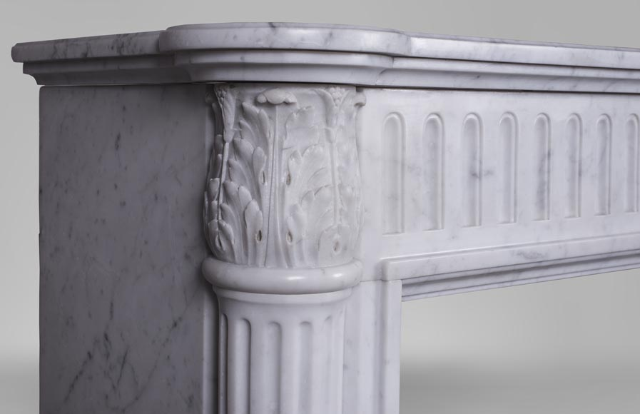 An antique Louis XVI style fireplace, made out of Carrara marble, with half-columns-3