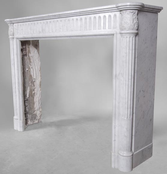 An antique Louis XVI style fireplace, made out of Carrara marble, with half-columns-5