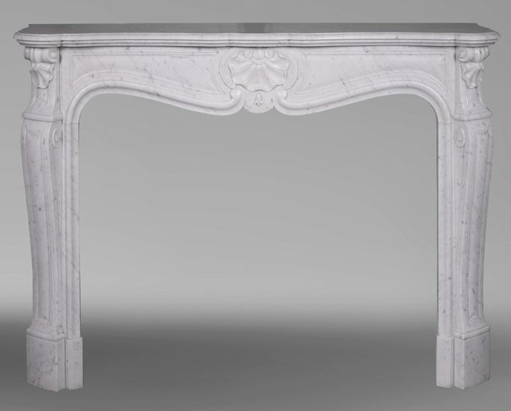 An antique Louis XV style fireplace with three shells, made out of Carrara marble-0