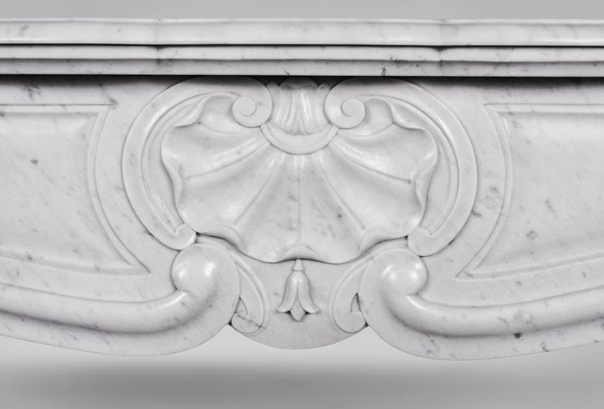 An antique Louis XV style fireplace with three shells, made out of Carrara marble-1