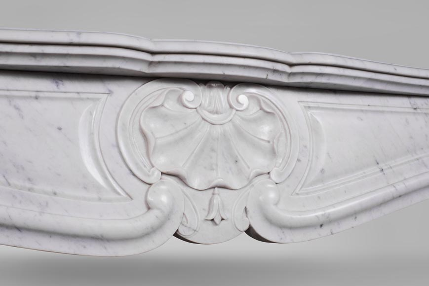 An antique Louis XV style fireplace with three shells, made out of Carrara marble-2