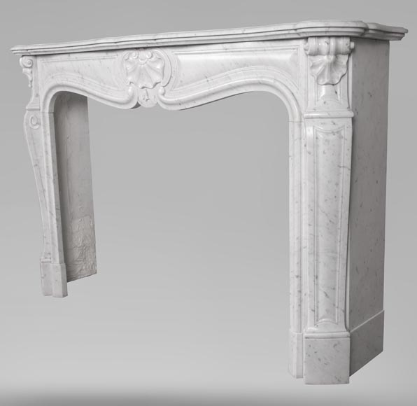 An antique Louis XV style fireplace with three shells, made out of Carrara marble-6