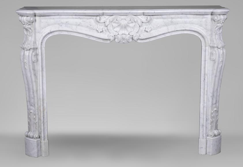 An antique Louis XV style fireplacewith three shells made out of Carrara marble-0