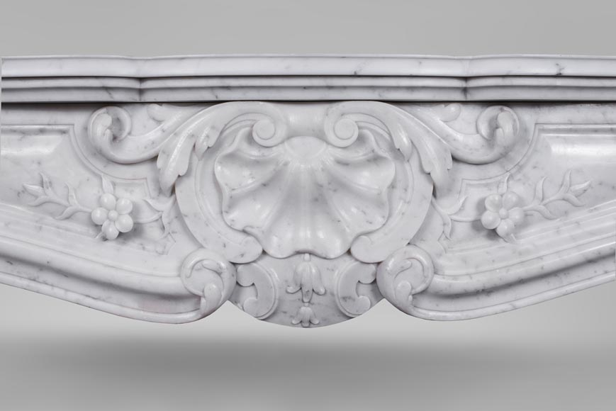 An antique Louis XV style fireplacewith three shells made out of Carrara marble-1