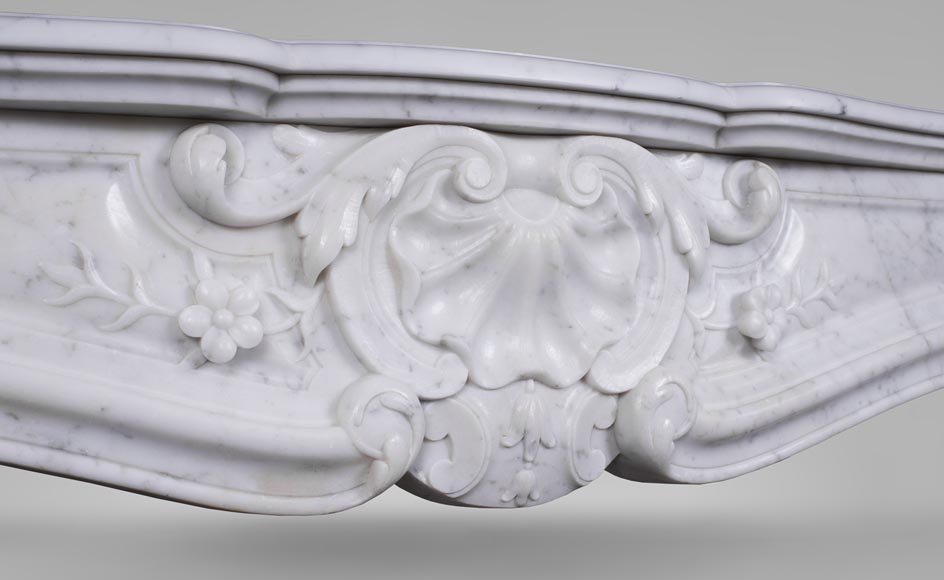 An antique Louis XV style fireplacewith three shells made out of Carrara marble-2