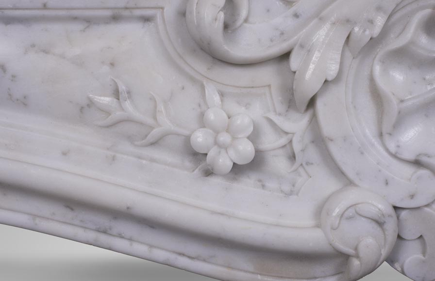 An antique Louis XV style fireplacewith three shells made out of Carrara marble-3