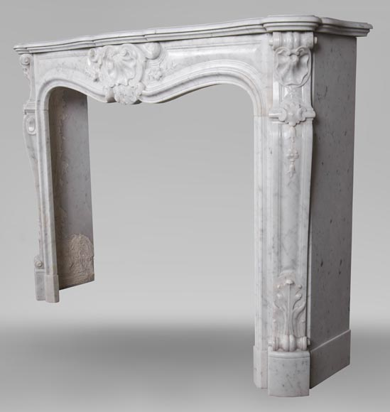 An antique Louis XV style fireplacewith three shells made out of Carrara marble-7