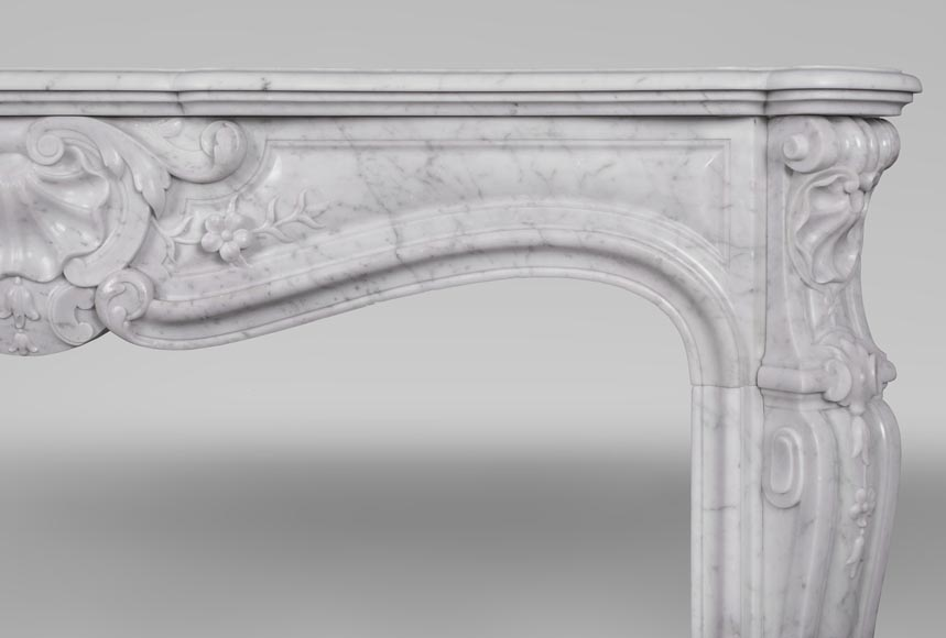 An antique Louis XV style fireplacewith three shells made out of Carrara marble-8