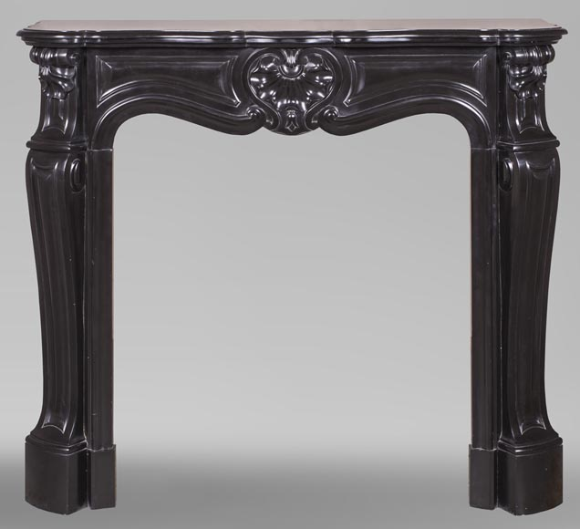 An antique Louis XV style fireplace with three shells, made out of Noir fin de Belgique marble-0