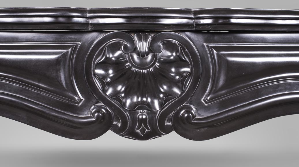 An antique Louis XV style fireplace with three shells, made out of Noir fin de Belgique marble-1