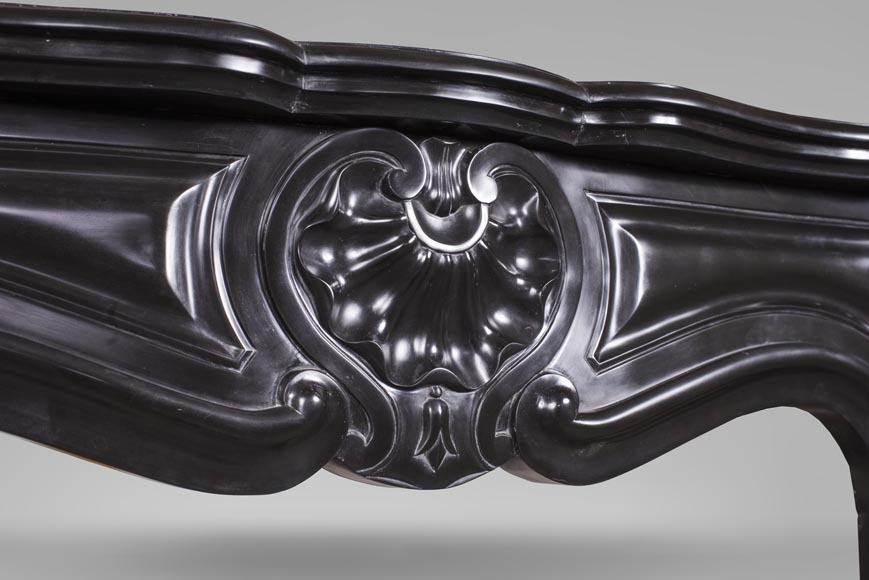 An antique Louis XV style fireplace with three shells, made out of Noir fin de Belgique marble-2