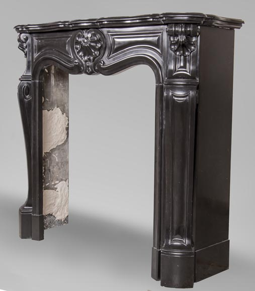 An antique Louis XV style fireplace with three shells, made out of Noir fin de Belgique marble-6