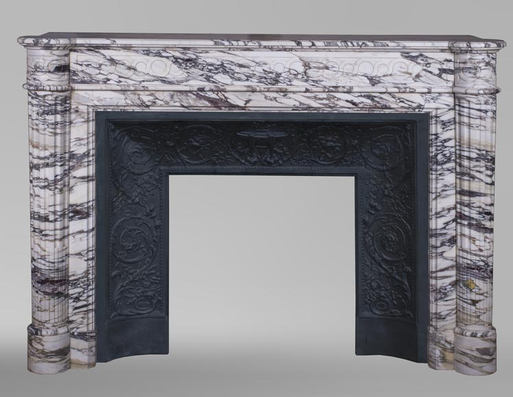 An antique Louis XVI style fireplace with half-columns made out of Brèche Violette marble-0