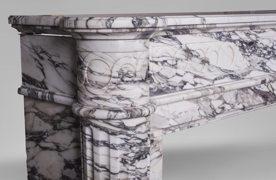 An antique Louis XVI style fireplace with half-columns made out of Brèche Violette marble-2