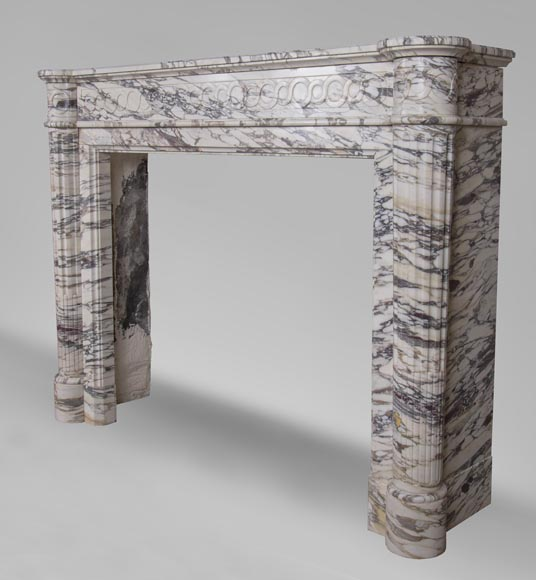 An antique Louis XVI style fireplace with half-columns made out of Brèche Violette marble-8