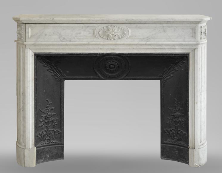 An antique Louis XVI style fireplace with rounded corners, made out of Carrara marble-0