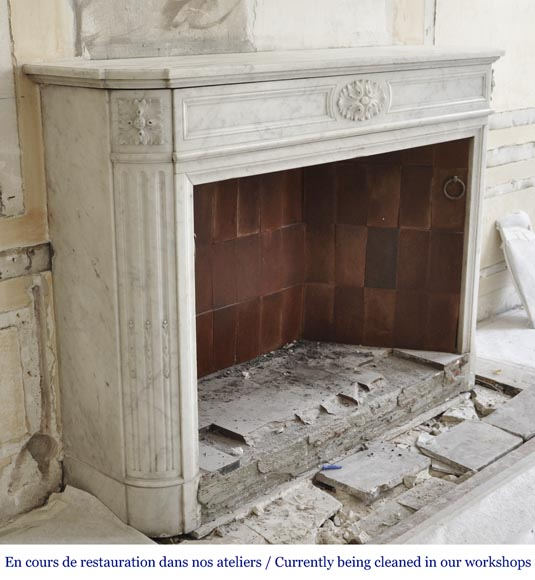 An antique Louis XVI style fireplace with rounded corners, made out of Carrara marble-2