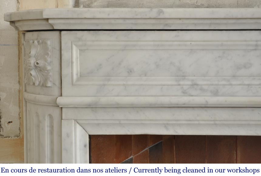 An antique Louis XVI style fireplace with rounded corners, made out of Carrara marble-3
