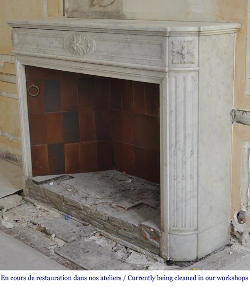 An antique Louis XVI style fireplace with rounded corners, made out of Carrara marble-5
